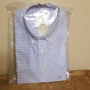 Haggar button down shirt. New never opened